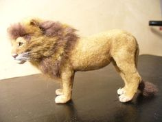 Miniature Male Lion with fur in 1:12 scale by Linda Fisher - Photo Courtesy Linda Fisher copyright 2008 Used with Permission