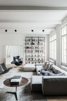 This could work in the front room - couch on the wall side and shelves somewhere?