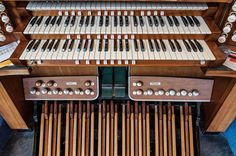 Church organ keys pedals and stop controls.