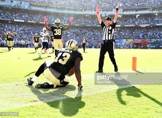 Michael Thomas of the New Orleans Saints celebrates his touchdown catch with Travaris Cadet to trail 2834 to the San Diego Chargers during the fourth...