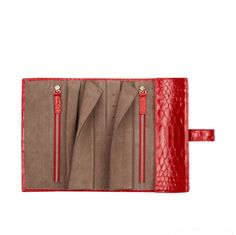 This luxury python leather travel roll is small enough to come everywhere and large enough to store all your jewellery on the go. The roll is available in alternative colours and leathers.The perfect travel companion - this jewellery travel roll is perfect for storing your jewellery when on the move. Zipped compartments can store away safely necklaces, bracelets and earrings. Further tab can store stud earrings or smaller earrings on wire, while a ring finger roll can easily fit many rings…
