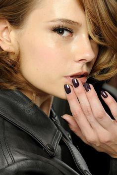 Jet black nails.