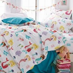 Whimsical mermaid kids sheets and bedding set. Displays long-haired mermaids floating amongst colorful sea life. 200-TC cotton percale.