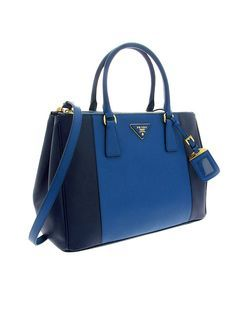 8a1acc8e5490bd Prada just launched their Spring collection of Saffiano Lux handbags and  let me tell you, if money was no object I'd probably buy every single one  of them.