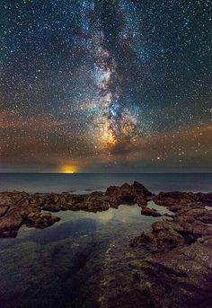 """Milky Way Galaxy Milky Way over Tirreno by Alessio Andreani on """"The night sky over the Mar Tirreno (italy), Tyrrhenian Sea in english, The orange light in the background come from the island of Ponza.""""Ponza, province of Latina , Lazio Beautiful Sky, Beautiful World, Beautiful Places, Beautiful Pictures, Landscape Photography, Nature Photography, Sky Full Of Stars, Milky Way, Science And Nature"""