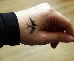 bird tattoo, hand tattoo
