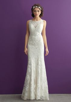 Vintage-inspired lace is featured along the bateau neckline and V-back of this sheath bridal gown.