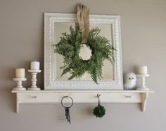 Love the look of a wreath in front of a mirror.