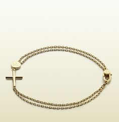 bracelet with cross and gucci trademark engraved tag