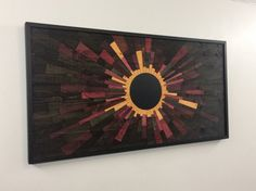 Hi, welcome to Stains and Grains, custom wood wall art. DUE TO POPULAR DEMAND - TURNAROUND TIMES ARE EXTENDED TO 3.5 MONTHS+ FOR ALL CUSTOM ORDERS. Contact me for lead time if you have a certain date you need it by. Using hundreds of precisely cut pieces, specialized mixes of stain, and some painstaking fitment, I present Venusian eclipse. This is the pinnacle of my collection, a guaranteed conversation starter, a stunningly beautiful piece of art that is unlike anything else you will…