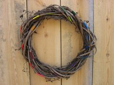 Twig wreath w/ colored string...would look great in any color palette, maybe with some fabric/flowers?