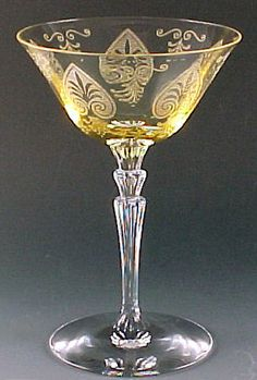 Fostoria Trojan Etched Topaz Yellow Champagne Sherbet Tall 6 1/8 Inches Stemware Elegant Depression Glass Vintage Glassware Etch by CatladykatesGlass on Etsy https://www.etsy.com/listing/216446568/fostoria-trojan-etched-topaz-yellow Just got 3 of these glasses plus the matching bread and butter plates at goodwill for about $5!