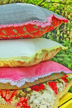 Gotta make me a stack of my own vintage pillows with my collection of vintage fabric and don't forget to crochet around the edges of some, just because i flippin well can.