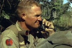 LTC Hal Moore, Commander of the 1st Battalion, 7th Cavalry, on the radio during the fight for LZ X-Ray in the Ia Drang Valley of Vietnam. Photo extracted from US Army motion picture footage. (Nov 1965)