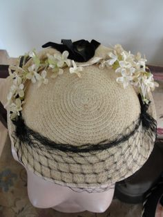 Antique weaved mini hat with netting, velvet bow, and flowers by BarnshopAntiques on Etsy