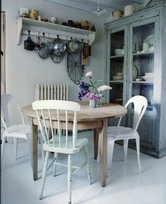 I think I need a round table to maximize my space. Could still fit 6 chairs around it. Also love the antique look here.