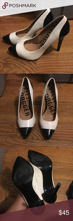 Kelsi Dagger Black And White leather pumps size 7 Shiny patent leather black and white. Some markings to exterior. Knock to front toe. Some scrapes at bottom of back heel. Overall good pre owned condition. Super adorable!! Kelsi Dagger Shoes Heels