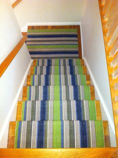 Dash & Albert's Marina Stripe expertly installed on our client's staircase