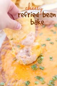 Six Sisters Cheesy Refried Bean Bake is so good with tortilla chips!