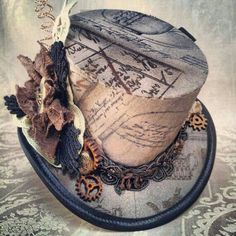 """old"" steampunk hat with vintage-looking writings and gears. I want it!"