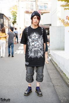 Cheke is a the GazettE Official fan who we met in #Harajuku. His look includes a super-creepy doll necklace, an evil clown ring, an Eye of Providence t-shirt, a Long Clothing beanie, a lip piercing, and Dr. Martens.