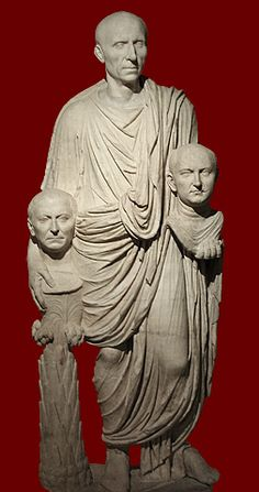 """so-called """"Barberini Statue"""", Roman, late first century BCE This togate statue of a man of the senatorial class depicts a man holding portraits of his ancestors. He holds a bust of his father in his left hand and encircles a portrait of his grandfather on a palm-tree support (indicating that he was probably a successful general) with his right hand. The head of the statue is ancient but does not belong to the body.  Rome, Museo Montemartini (Capitoline Museums)."""