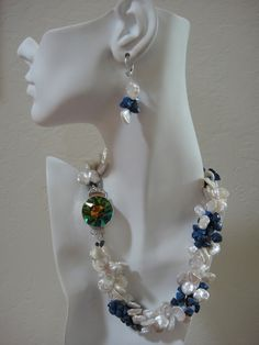Keshi White Pearl and Lapis three strand Necklace and Earrings $1600.00