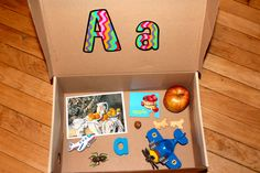 alphabet box- to introduce the letters of the alphabet, use a box with attached lid.  display the upper and lower case letter sample inside the lid.  place items that begin with that letter in the box.  lilah LOVES her alphabet boxes and this has worked really well for her.