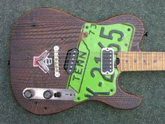 Custom electric guitars and basses made from local and salvaged materials Custom Electric Guitars, Custom Guitars, Rockabilly Guitar, Beautiful Guitars, Music Instruments, Bass Guitars, Axe, Swords, Drums