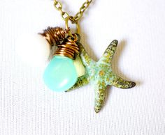 Love the blue.   Starfish Necklace with Gemstones and Glass, Wire Wrapped Pendants and Teal Verdigris Starfish