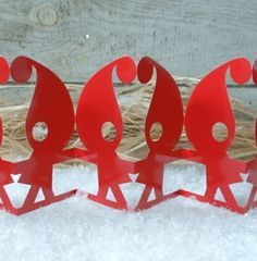Santas little helpers on a row by Eva Levin #nordicdesigncollective #santa #row #red #christmas #paper #paperart #fold #cut #xmas #decoration #christmasdecoration #evalevin #elf #santaslittlehelper #help #santaklaus