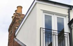 L shape loft conversion to a Victorian property with French doors and balcony