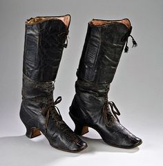 pair of tiny and narrow sized late 1860's lady's riding boots which were lined in white cotton and pink leather. They are field boot in style rather than the typical dress boot (so all you historical re-enactors out there who ride side saddle, field boots WERE worn then for riding!) and have square toed straight soles with spur rests on BOTH boots.