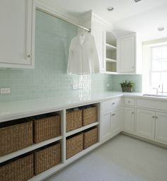 Contemporary laundry room features white shaker cabinets and green glass subway tile backsplash flanking single clothes rod over open shelving filled with woven baskets over vintage hex floor. Laundry Room Baskets, Farmhouse Laundry Room, Laundry Room Storage, Laundry Rooms, Cabinet Storage, Laundry Area, Design Shop, Küchen Design, Design Ideas
