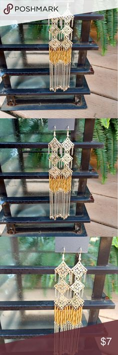 😀New😀 beautiful dangly Express earrings. These are truly a statement piece for any woman's closet. Very lightweight and they measure 6 inches. Express Jewelry Earrings