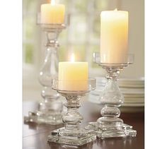 These are the candle holders that my cat broke this morning :(  I found them for a song at a thrift store, don't know if they can be replaced at PB prices :(  Clear Glass Square Base Pillar Holders #potterybarn