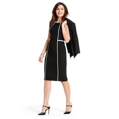 This boldly contrasting black and white dress highlights each curve for a sleek and slim look. #WHBM #WorkMastered