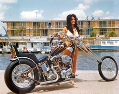 Picture of a Girl Next to the Water on a Vintage Chopper View EXCLUSIVE Images on Our Pinterest Page- Follow Us - http://pinterest.com/lcralliesinfo/ Ride safe, JB LightningCustoms.com Motorcycle Rallies Site http://www.lightningcustoms.com/rally.html