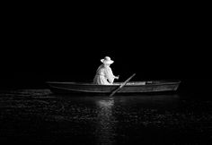 Some Are White Light - Woman in a white gown sailing on a small lake.