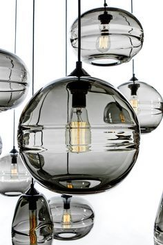 These lights in clear glass. The rim around the center creates a very beautiful light. Love this option or the kitchen. Makes the kitchen more modern instead of chain light. Option for kitchen John Pomp Hand Blown Sculpted Glass Pendants Cool Lighting, Modern Lighting, Lighting Design, Lighting Ideas, Photo Lighting, Light Fittings, Light Fixtures, Crystal Pendant Lighting, Pendant Lamps