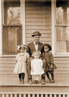 "blackhistoryalbum: ""FAMILY MAN | 1915 Toby James with his daughters Myrtha, Edna and Mauranee. Lincoln, Nebraska, circa 1915. Photo by by John Johnson. """