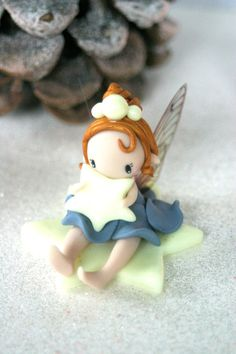Hey, I found this really awesome Etsy listing at https://www.etsy.com/listing/257787375/fairy-sitting-on-a-glow-in-the-dark-star