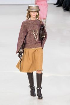 Chanel wrap, long gloves with bracelets. Many versions of this on the runways