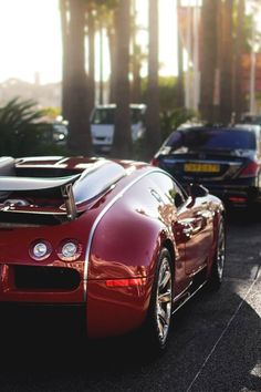 red Bugatti Veyron in traffic | luxury sports car