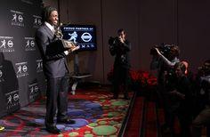 Dec. 10, 2011  Heisman Trophy winner Robert Griffin III holds the award during a news conference in New York.  Craig Ruttle / Associated Press