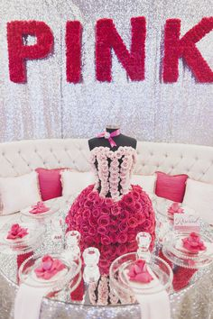 Victoria Secret Inspired PINK Quinceañera  Black, White, Pink with Ghost Chairs, Acrylic Tables  Corset Pink Floral Centerpiece, Silver Backdrop, PINK paved flowers  ©Michelle Able Photography 2013 www.occasioproductions.com at Galveston Island Convention Center At San Luis Resort.
