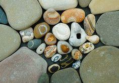 stones with circles, holes, lines by Jos van Wunnik, via Flickr