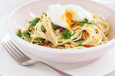 Perfectly poached eggs top off this bacon and herb-infused family-friendly meal.
