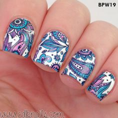 Nail art at its finest. Definitely brings art to the game. These beautifully drawn feathers and flowers with a watercolor inspired color is really a masterpiece and a must-have.