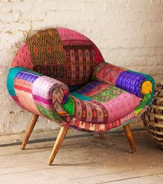 Take an armchair journey to India! Inspired by the kaleidoscopic jewel tones of the subcontinent with a dose of mid-century modern design, this cozy armchair celebrates color and function. Each chair is unique.